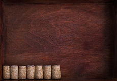 Row of wine corks into dark box. Row of wine identical corks into dark box Royalty Free Stock Image