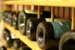 Row of wines. A rack full of winebottles Stock Photos