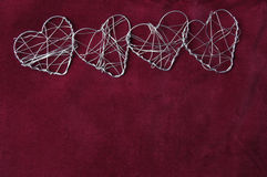 A row of wire hearts Stock Photos