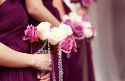 Row of women with flowers Royalty Free Stock Image