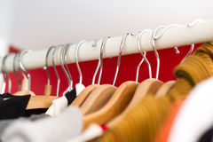 Row of women's clothes hanging in closet. Row of womens clothes hanging in white and red closet Stock Images