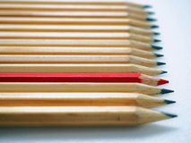 Row of Wood Pencils. Being Different Concept with Wooden Pencils Arranged in a Row Royalty Free Stock Image