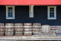 Row of wooden barrels on platform Royalty Free Stock Images