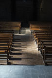 Row of wooden benches inside a church Stock Images