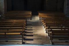 Row of wooden benches inside a church Stock Photos