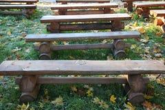 Row of wooden benches Stock Photos