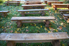 Row of wooden benches Stock Images