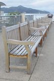 Row of wooden benches of wharf Stock Photography