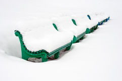 Snow on the benches. Stock Photo