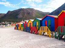 Row of wooden brightly colored huts Stock Photo
