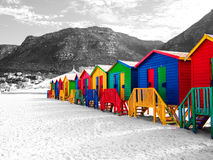 The row of wooden brightly colored huts. Stock Images