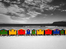 The row of wooden brightly colored huts. Royalty Free Stock Photos