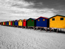 The row of wooden brightly colored huts. Royalty Free Stock Image