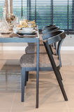 Row of wooden chair with table set on wooden table Stock Images