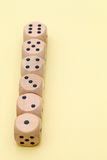 Row of wooden dice. Row of many wooden dice on a yellow background Stock Photography