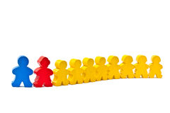 Row of wooden doll. Row of wooden doll on a white background stock photos