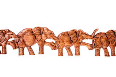 Row of wooden elephants Royalty Free Stock Images