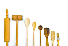 Row of wooden kitchen utensils Royalty Free Stock Images