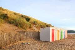 Row of wooden painted brightly coloured beach huts Royalty Free Stock Photo