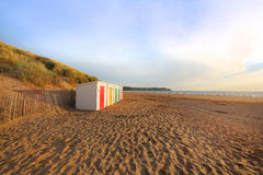 Row of wooden painted brightly coloured beach huts Stock Image