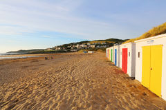 Row of wooden painted brightly coloured beach huts Royalty Free Stock Photos