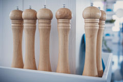 Row of wooden pepper mills Stock Image
