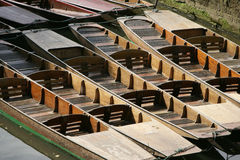 Row of wooden punts Stock Images