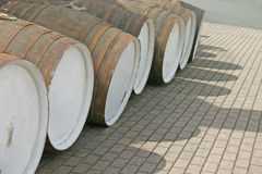 Row of wooden whisky barrels Stock Image