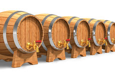 Row of wooden wine barrels with valves Royalty Free Stock Image