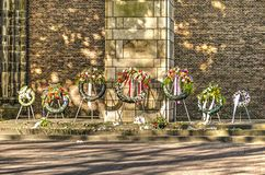 Row of wreaths at Dom Square. Utrecht, The Netherlands, May 7 2018: Row of wreaths at the resistance monument in front of Dom Church, for the occasion of Royalty Free Stock Photos