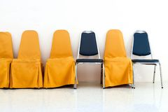 A row of yellow chairs and blue chair Royalty Free Stock Images