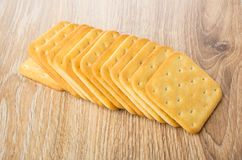 Row of crackers on wooden table Stock Photo