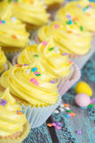 Row of yellow Easter cupcakes Stock Image