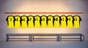 Row of Yellow Football shirts Shirts 3-5 Stock Images