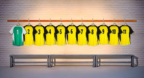 Row of Yellow and Green Football shirts Shirts 1-11 Stock Images