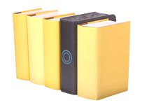 Row of yellow hardback books with a computer hard Stock Photos