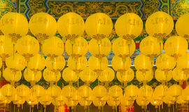 Row of yellow lantern hang in temple. Many beautiful lamp suspend for special festival Stock Photography