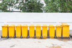 Row of yellow plastic garbage bin Royalty Free Stock Photography
