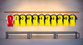 Row of Yellow and Red Football shirts Shirts 1-11 Royalty Free Stock Images