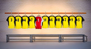 Row of Yellow and Red Football shirts Shirts 3-5 Stock Images