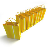 Row of yellow stripped shopping bags. 3D rendering of high quality looking yellow stripped shopping bags against a white background Stock Photo
