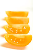Row of Yellow Tomato Quarters Stock Image