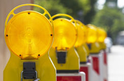 Barricade lights. A row of yellow traffic barricade lights on a street stock photos
