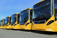 Row of Yellow Volvo 8900 Intercity Buses. LIETO, FINLAND - APRIL 5, 2014: Row of Yellow Volvo 8900 intercity buses parked on a yard. The 8900 has a Volvo D8K Royalty Free Stock Images