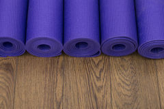 Row of yoga mats. Group of yoga mats on the floor in a studio Stock Images