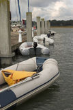 Row of zodiacs. Lined up at the dock Royalty Free Stock Photography
