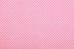 Różowa tkanina z kropkami, tło. Zdjęcia Stock