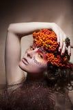 Rowan berry wreath. Retro style. Beauty woman face. Rowan berry - autumn sorb wreath. Retro style. Beauty woman face Royalty Free Stock Photo
