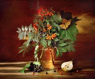 Rowanberry branches in jar Stock Photo