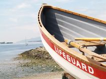 Rowboat. A boat with oars on shore waiting to be used Royalty Free Stock Photos